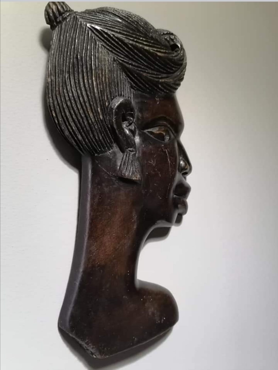 A wooden face Figurine of a female
